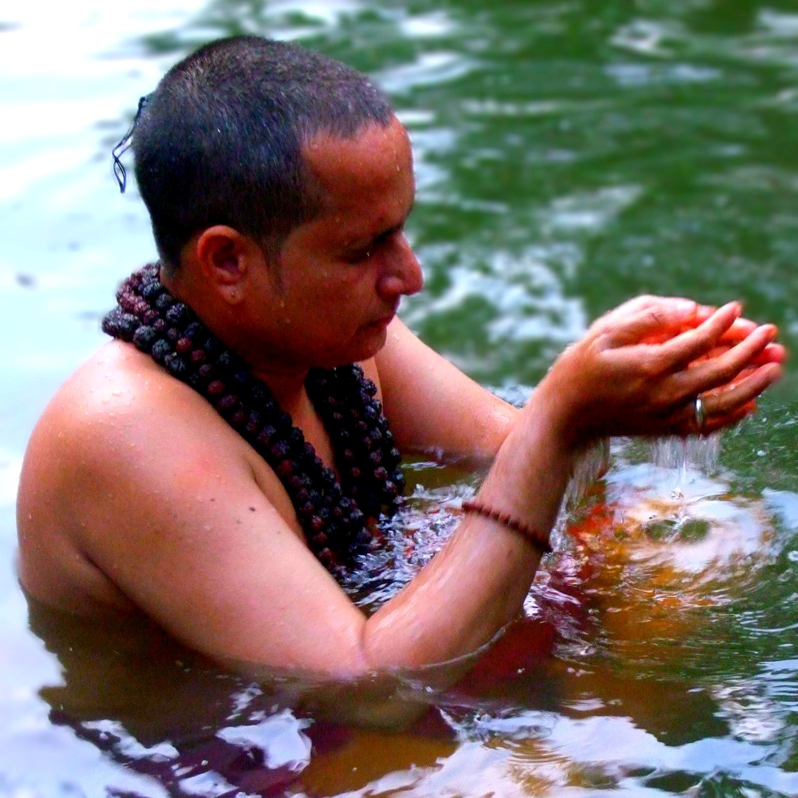 famous poet preeth nambiar having ceremonial bath in the river
